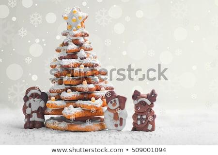 Christmas card with gingerbread figurines Stock photo © balasoiu