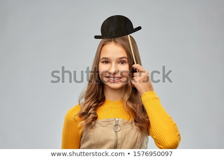 smiling teenage girl with mustaches party prop Stock photo © dolgachov