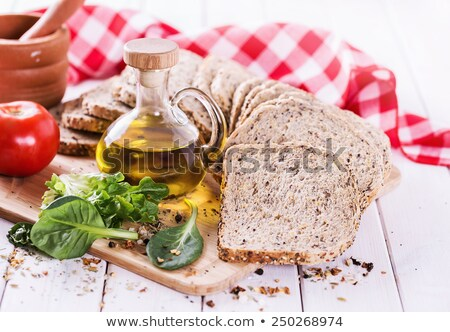 Fresh loaf of seeded bread on white background. Traditional bakery heritage. Stock photo © DenisMArt