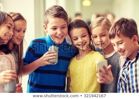 Mosolyog lány iszik üdítő konzerv italok Stock fotó © dolgachov