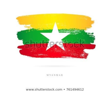 Myanmar flag and hand on white background. Vector illustration Stock photo © butenkow