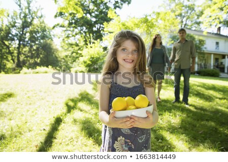 Smiling child in dapled sunlight Stock photo © lovleah