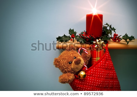 Christmas candle with starburst and holly. Stock photo © RTimages