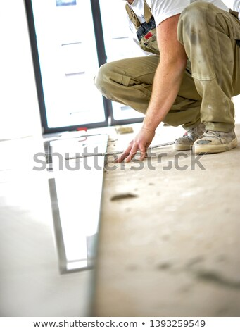 tiler taking measurements Stock photo © photography33