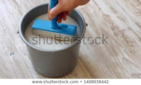 Man applying wallpaper paste Stock photo © photography33