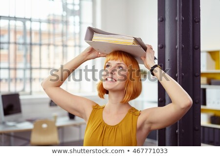 Redheaded businesswoman carrying paperwork Stock photo © photography33