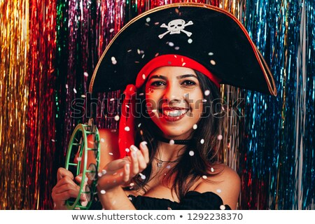 Young beautiful woman in costume of pirate on black background stock photo © pzaxe