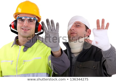 Injured tradesman comparing his hand to a healthy colleague Stock photo © photography33