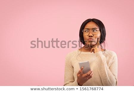 valami · gondolkodik · fiatal · nő · gondolkodik · nő · mosoly - stock fotó © jayfish