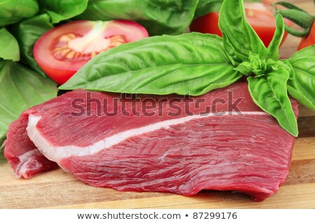 Piece of fresh meat from basilicas and a tomato Stock photo © Masha