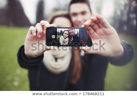Mixed Race Couple Taking Self Portrait at the Park Stock photo © feverpitch