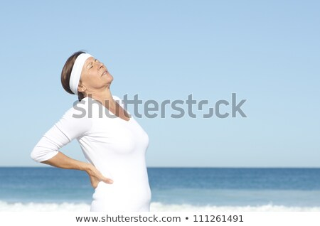 Senior woman suffering backpain sky background Stock photo © roboriginal