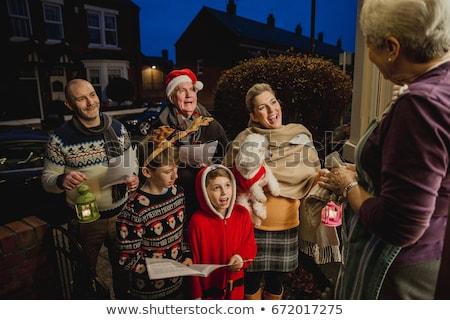 Woman singing Christmas carols Stock photo © photography33