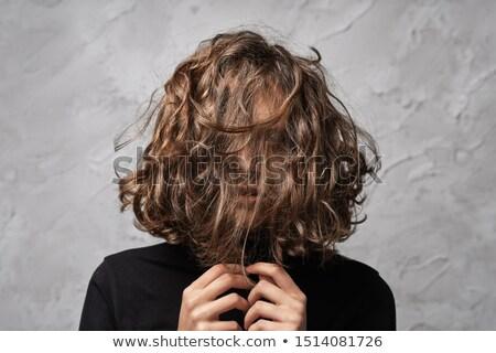 Stock photo: Glamorous Brunette Dishevelling Her Hair