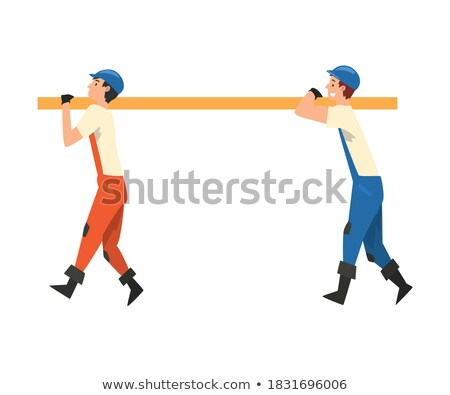 Construction couple carrying timber Stock photo © photography33