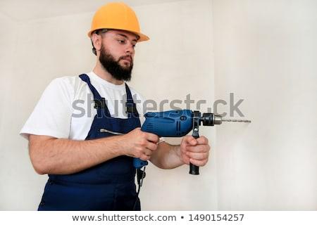 Homme maçonnerie forage bâtiment travailleur étage Photo stock © photography33