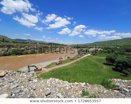 Kotrógép folyó kész munka út építkezés Stock fotó © rufous