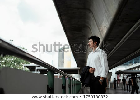 Stock photo: casual man outdoor with hand in pocket looks down