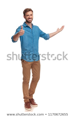 casual man with hand in pocket shows ok sign Stock photo © feedough