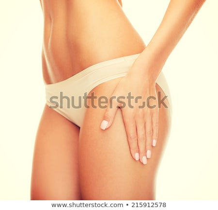 woman in cotton underwear showing slimming concept Stock photo © dolgachov
