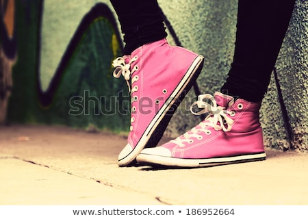 Close up of red sneakers worn by a teenager. Stock photo © photocreo