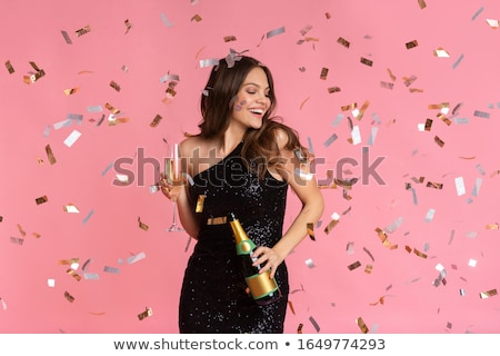 Luxury. Young Woman in Evening Dress with Glass of Champagne Standing at the Window in Sunshine Stock photo © gromovataya