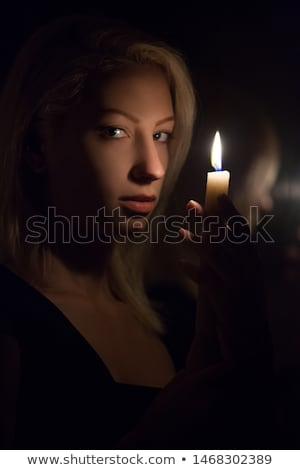 Woman with burning candle Stock photo © maros_b