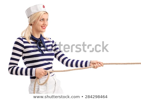 Woman sailor in tug of war concept Stock photo © Elnur
