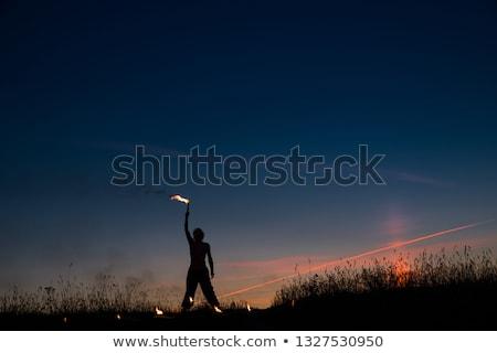 Hand holding colored smoke Stock photo © cherezoff