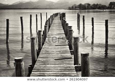 Weathered wooden jetty in calm water Stock photo © sarahdoow