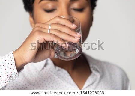 Belo africano mulher estúdio água doce jovem Foto stock © Kzenon