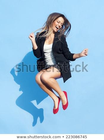 Mutlu iş kadını dans tam uzunlukta portre yalıtılmış Stok fotoğraf © elwynn