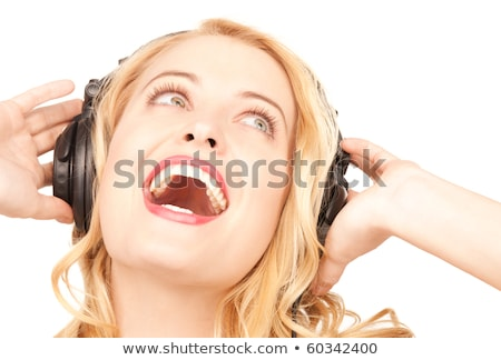 alluring blond woman listening to relaxing music stock photo © konradbak