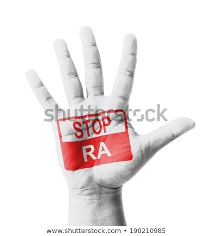 Stop RA on Open Hand. Stock photo © tashatuvango