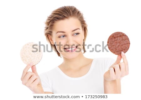 Foto stock: Woman Deciding Whether To Eat Healthy Food Or Sweet Cookies She Craving