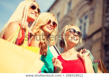 three beautiful girls with shopping bags stock photo © master1305