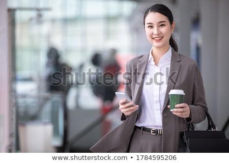 mutlu · kadın · oturma · tablo · tablet - stok fotoğraf © deandrobot