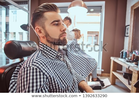 Handsome man getting his hair trimmed Stock photo © wavebreak_media