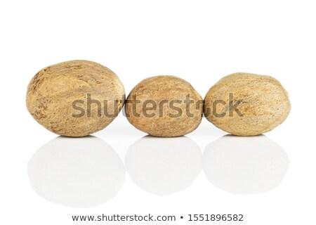 Rij organisch nootmuskaat zaad geïsoleerd witte Stockfoto © ziprashantzi