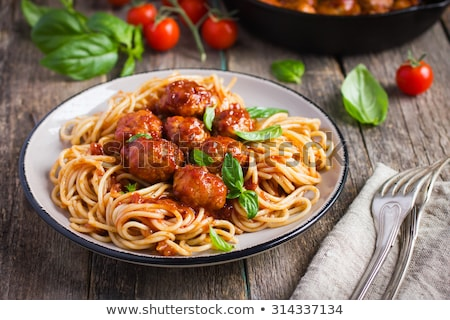 Spaghetti dinner with meatballs, sauce and salad. Stock photo © rojoimages