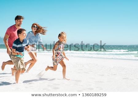 familia · hierba · cielo · sonrisa · azul · diversión - foto stock © paha_l