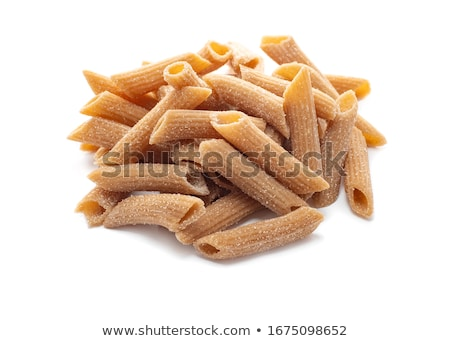 Closeup of uncooked wholewheat italian pasta - penne Stock photo © shutswis
