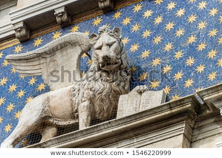 winged lion on facade of the bell tower at san marco square in v stock photo © andreykr