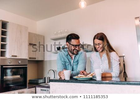 Couple déjeuner cuisine femme alimentaire maison Photo stock © ambro
