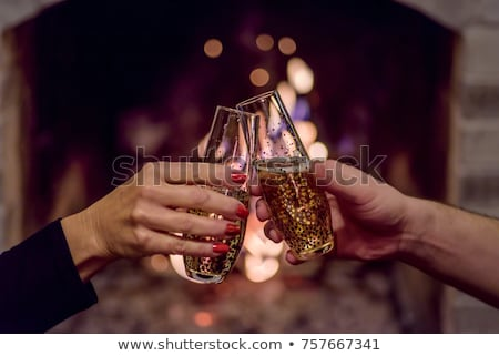 Happy young couple welcoming in the New Year Stock photo © dash