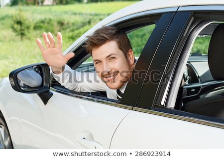 Stok fotoğraf: Sürücü · araba · yakışıklı · genç · hızlı · sığ