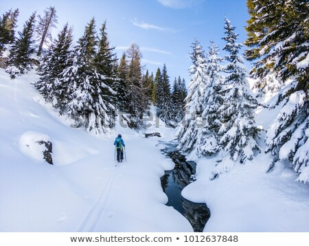 Stock photo: Beautiful landscape with ski run on frozen river