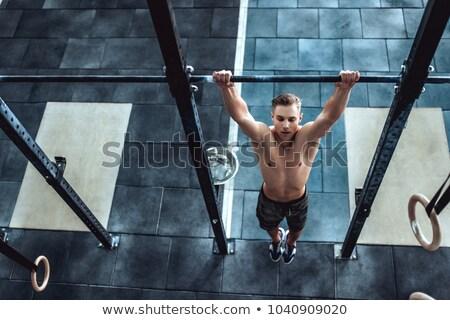 Férfi húz felfelé gimnasztikai gyűrűk fiatal Stock fotó © AndreyPopov