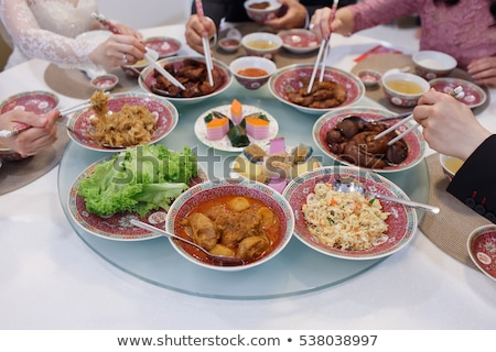Vertical image of Woman holding Chinese chopsticks Stock photo © deandrobot
