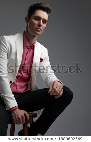 seated elegant young man resting elbows on knees Stock photo © feedough